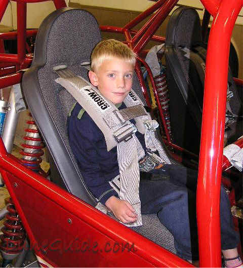Sand rail - Small child in an adult seat with booster pad and sternum latch