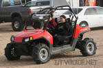 Polaris RZR with paddle tires in Glamis